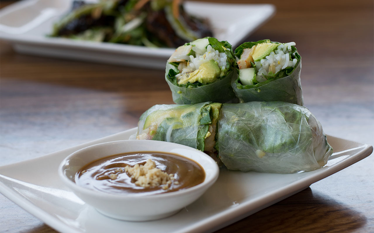 Grilled shrimp and avocado spring rolls with vermicelli, bean sprouts, cilantro, mint, cucumber, and lettuce in rice paper