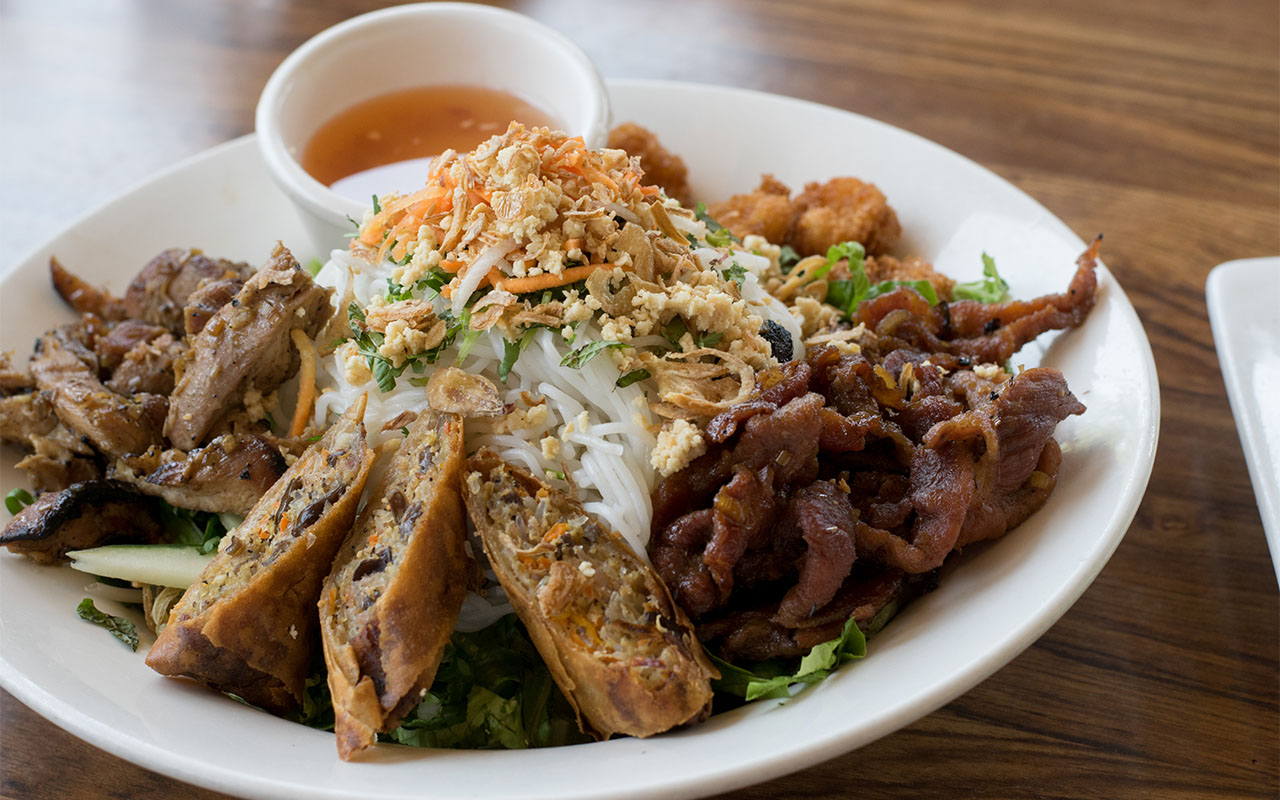 Combination vermicelli bowl- Panko shrimp, grilled pork, grilled chicken, and an egg roll over vermicelli noodles, lettuce, basil, mint, bean sprouts, crushed peanuts, and garlic